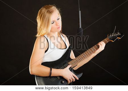 Woman Playing On Electric Guitar And Singing