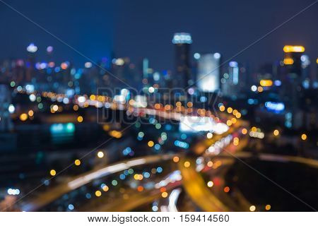 Twilight blurred light highway interchanged with city downtown background