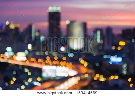 Abstract blurred lights city downtown and highway interchanged with dramatic sky background