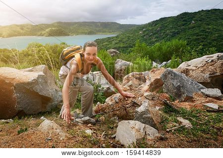 Young backpacker traveling along mountains happy female walking in the park discovering world summer vacation concept