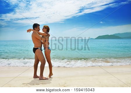 Happy married couple at the beach tropical beach