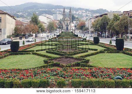 Guimarães, Portugal, November 10, 2016: Garden and church in Guimarães in Portugal.