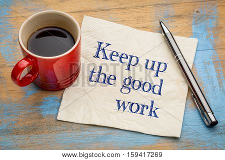 Keep up the good work - motivational handwriting on a napkin with a cup of espresso coffee