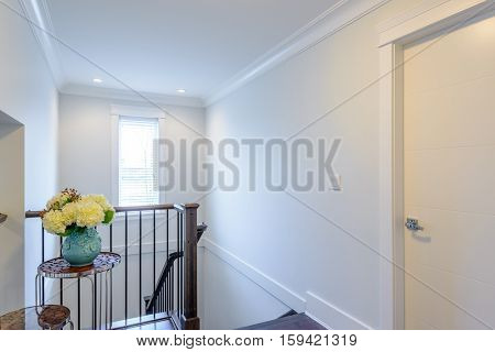 House interior. Entrance hallway with white door and hardwood floor.