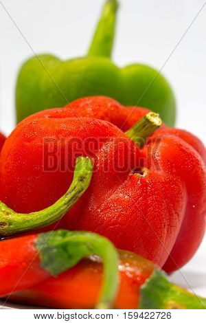 Red Green peppers isolated on white background