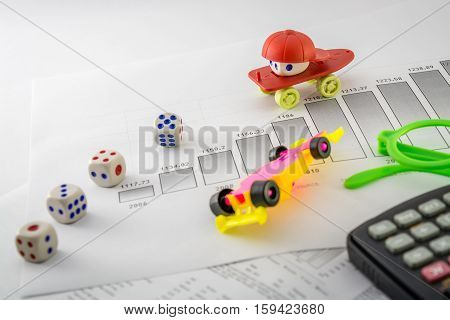 hot business table top view ,toy,line graph,graph,histogram,report,skateboard,cap,dice,queue,formula car,accident,calculator,glasses,documents,histogram