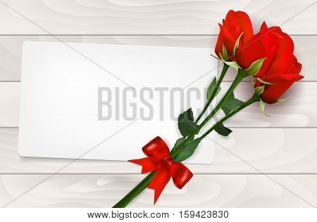 Blank Paper Card And Red Roses On Wooden Background