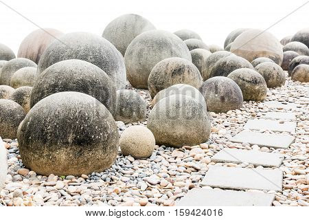 Stone Sphere In Garden With Footpath