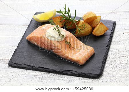 salmon steak with fried potatoes