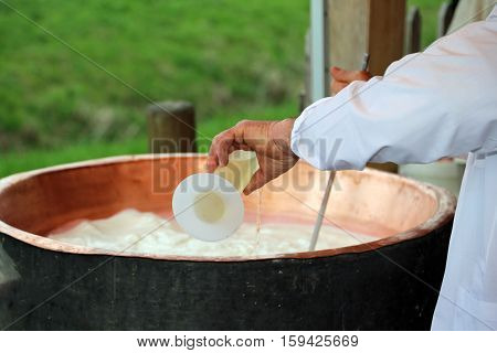 Cheesemaker Pour Rennet Into The Great Copper Cauldron