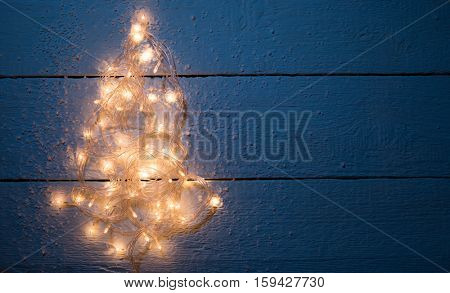 Christmas card with luminous garland