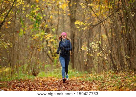 Slender girl running in park
