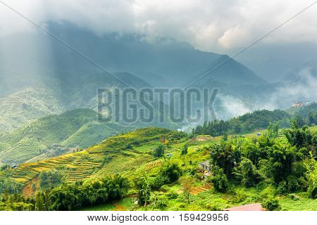 Scenic View Of Rays Of Sunlight Through Clouds In Mountains