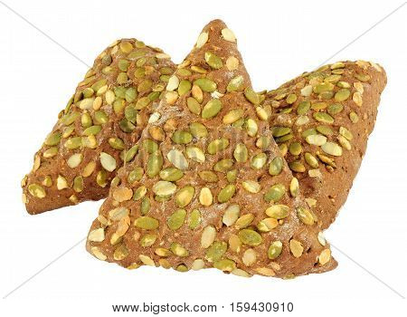 Pumpkin seed covered pumpernickel bread triangles isolated on a white background