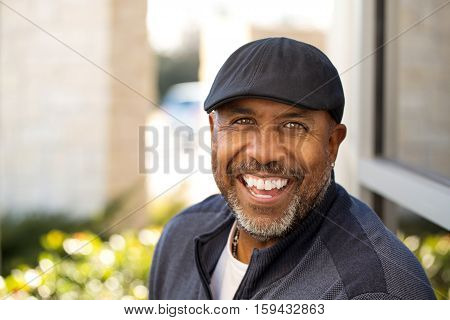 Portrait of an African American sitting outside.