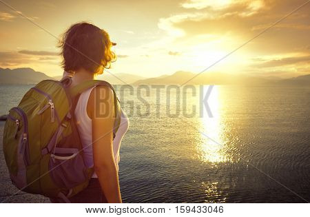 A young traveller looking at sunset on the islands. Traveling along Asia active lifestyle concept