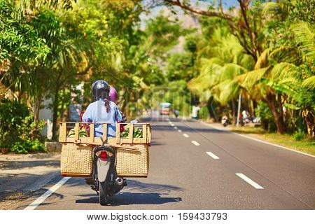 Balinese Man On Scooter