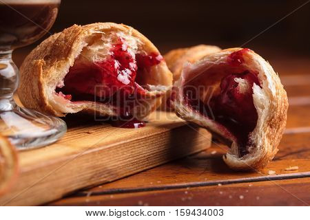 Croissant On Weathered Wooden Background