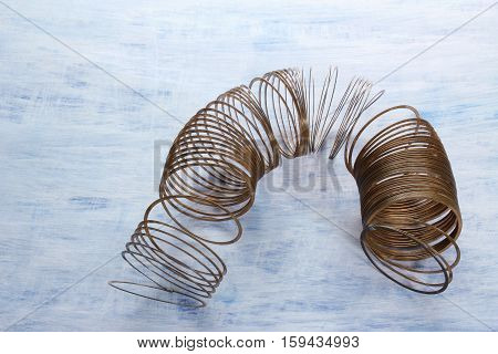 Metal Coil on a Rustic Textured Background