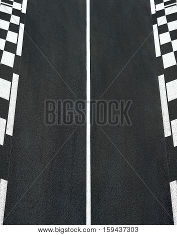 Texture of motor race asphalt and black white curb on Grand Prix street track