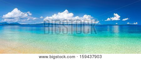 Panoramic view of a tropical beach against the backdrop of the island of Sulawesi. Indonesia