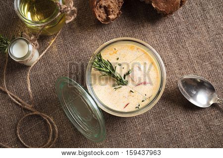Cheese Soup With Salmon Served In The Glass Jar