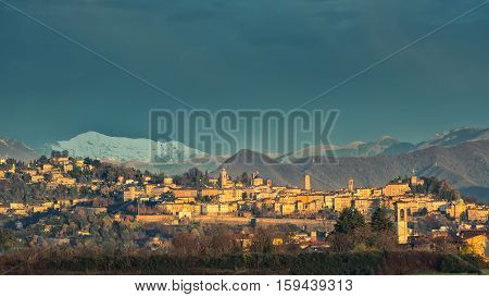 Bergamo Alta (high) with snow in the mountains