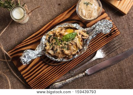 Baked Potatoes With Mushroom Sauce Served In Foil