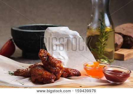 Chicken Wings In Spicy Sour Sauce Served On Paper