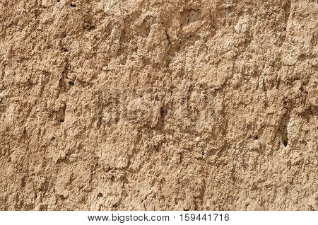 yellow red clay earthen wall texture background