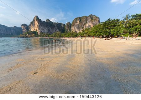 Tropical beach surrounded by cliffs in Ao Nang, Krabi province, Thailand