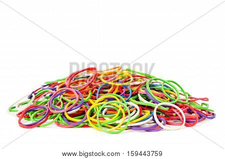 A multicoloured background showing a heap of colourful elastic rubber band isolated on white background.