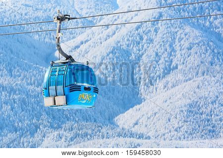 Bansko, Bulgaria - November 30, 2016: Bansko cable car cabin and snow mountain trees at the background