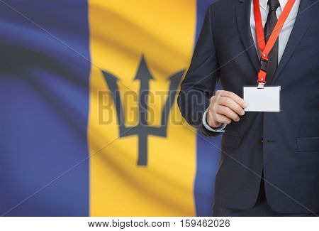 Businessman Holding Name Card Badge On A Lanyard With A National Flag On Background - Barbados