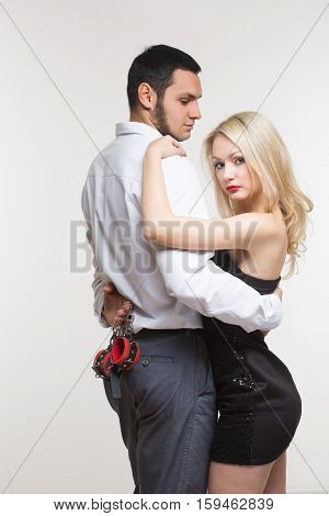 handcuffed sexy couple in handcuffs. Isolated on white background
