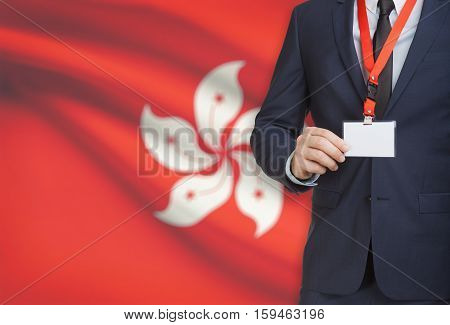 Businessman Holding Name Card Badge On A Lanyard With A National Flag On Background - Hong Kong