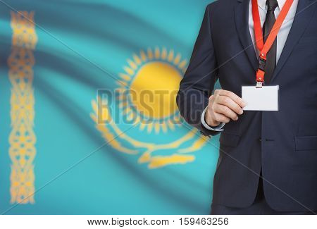 Businessman Holding Name Card Badge On A Lanyard With A National Flag On Background - Kazakhstan