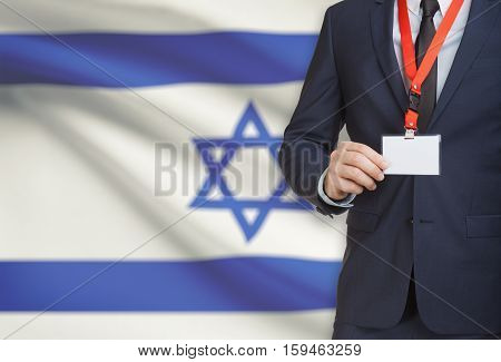 Businessman Holding Name Card Badge On A Lanyard With A National Flag On Background - Israel