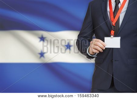 Businessman Holding Name Card Badge On A Lanyard With A National Flag On Background - Honduras