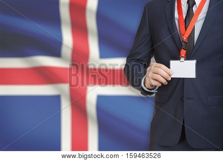 Businessman Holding Name Card Badge On A Lanyard With A National Flag On Background - Iceland