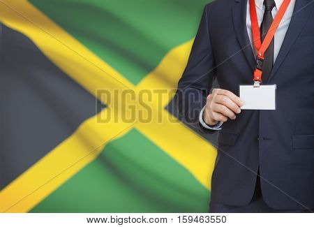 Businessman Holding Name Card Badge On A Lanyard With A National Flag On Background - Jamaica