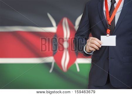 Businessman Holding Name Card Badge On A Lanyard With A National Flag On Background - Kenya