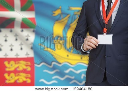Businessman Holding Name Card Badge On A Lanyard With A National Flag On Background - Saint Pierre A