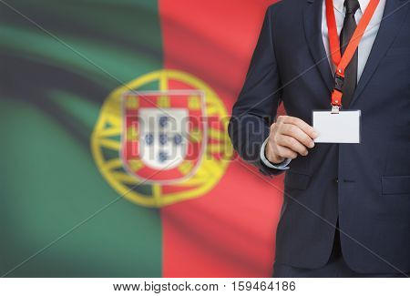 Businessman Holding Name Card Badge On A Lanyard With A National Flag On Background - Portugal
