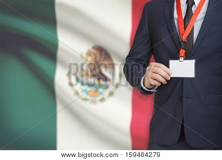 Businessman Holding Name Card Badge On A Lanyard With A National Flag On Background - Mexico