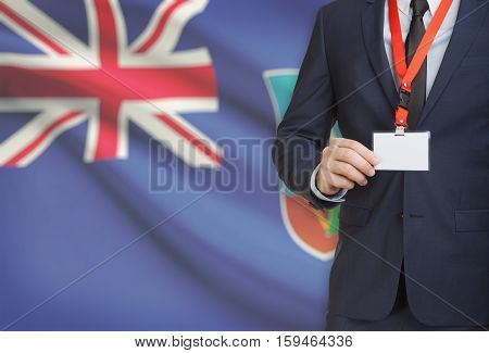 Businessman Holding Name Card Badge On A Lanyard With A National Flag On Background - Montserrat