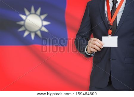 Businessman Holding Name Card Badge On A Lanyard With A National Flag On Background - Taiwan - Repub