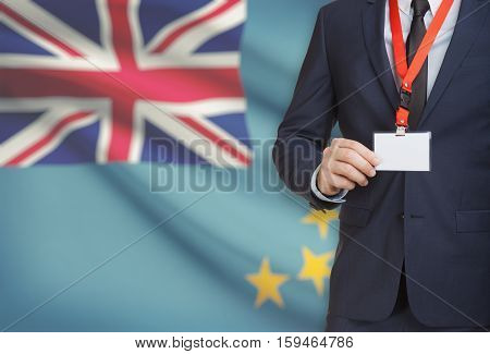 Businessman Holding Name Card Badge On A Lanyard With A National Flag On Background - Tuvalu