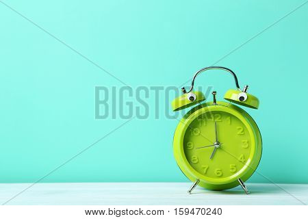 Alarm Clock With Googly Eyes On A Green Background
