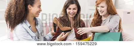 Cheerful Friends Admiring New Shoes